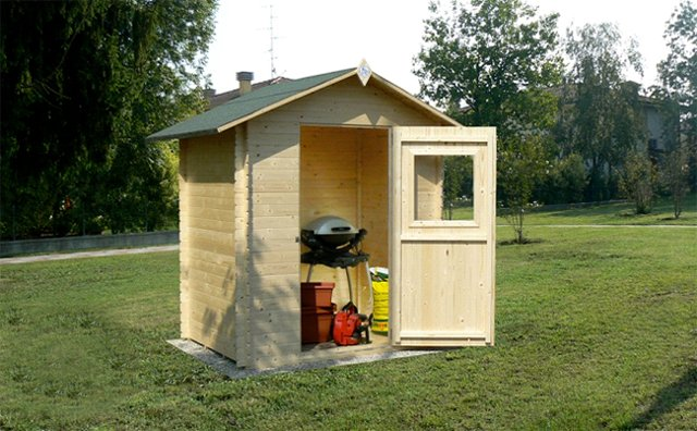 13 idee per usare le casette in legno da giardino arreda for Casette in legno da giardino